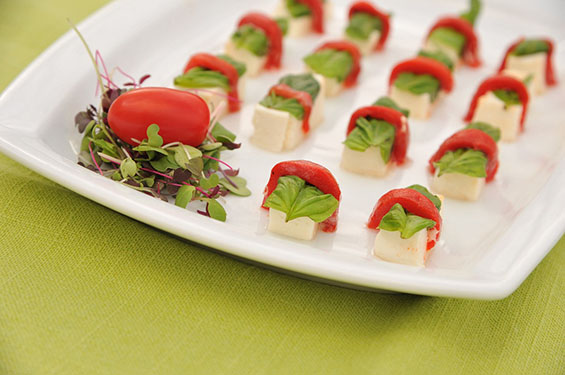 Mozzarella cubes wrapped in roasted pepper and basil - Gallery